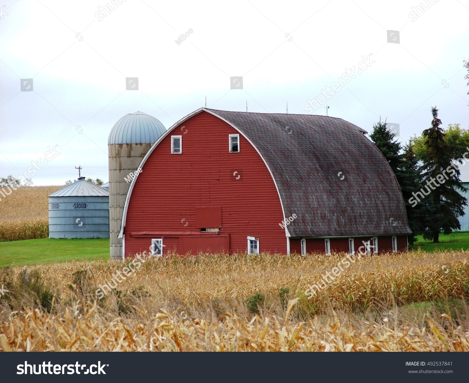 Beautiful Round Roof Red Barn And Silo