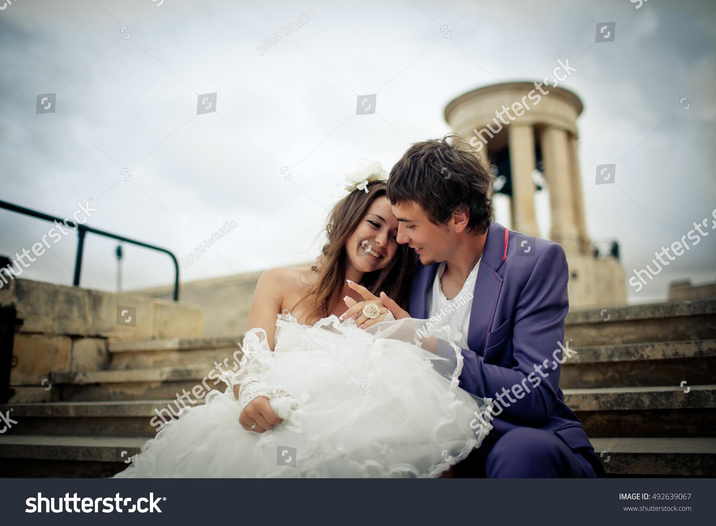 Radiant Bride Wedding Video Photography: Radiant Bride Light Dress Leans Grooms Stock Photo