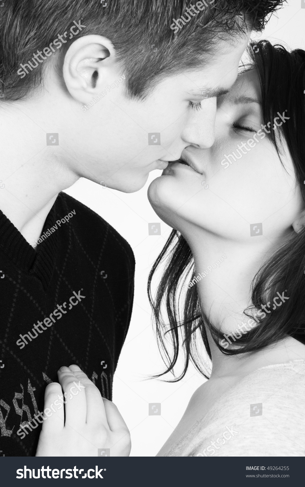 Young couple in love kissing in black and white