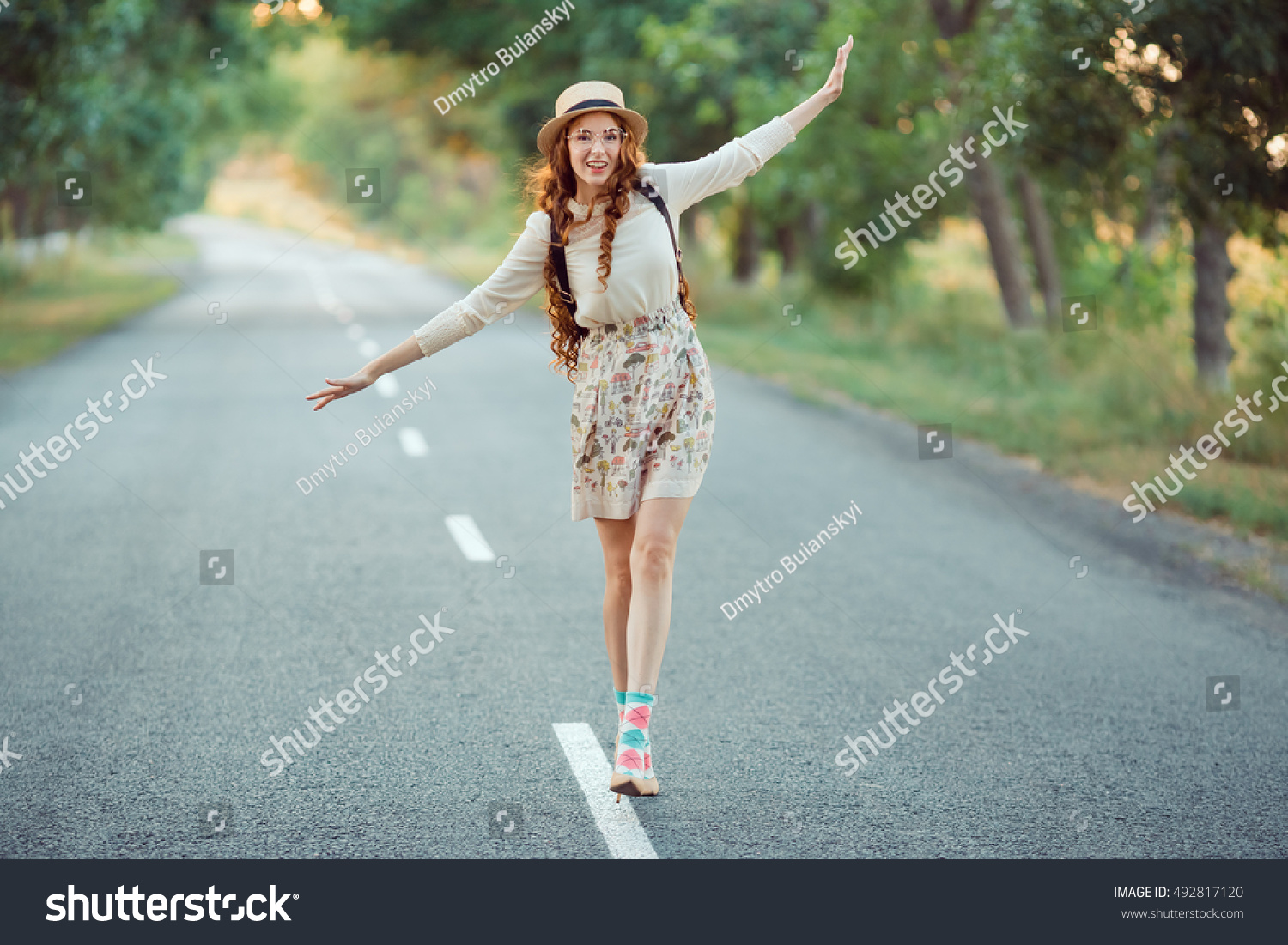 Young girl traveler enjoy the travel Happy smiling woman walking by the road Adventure is coming concept