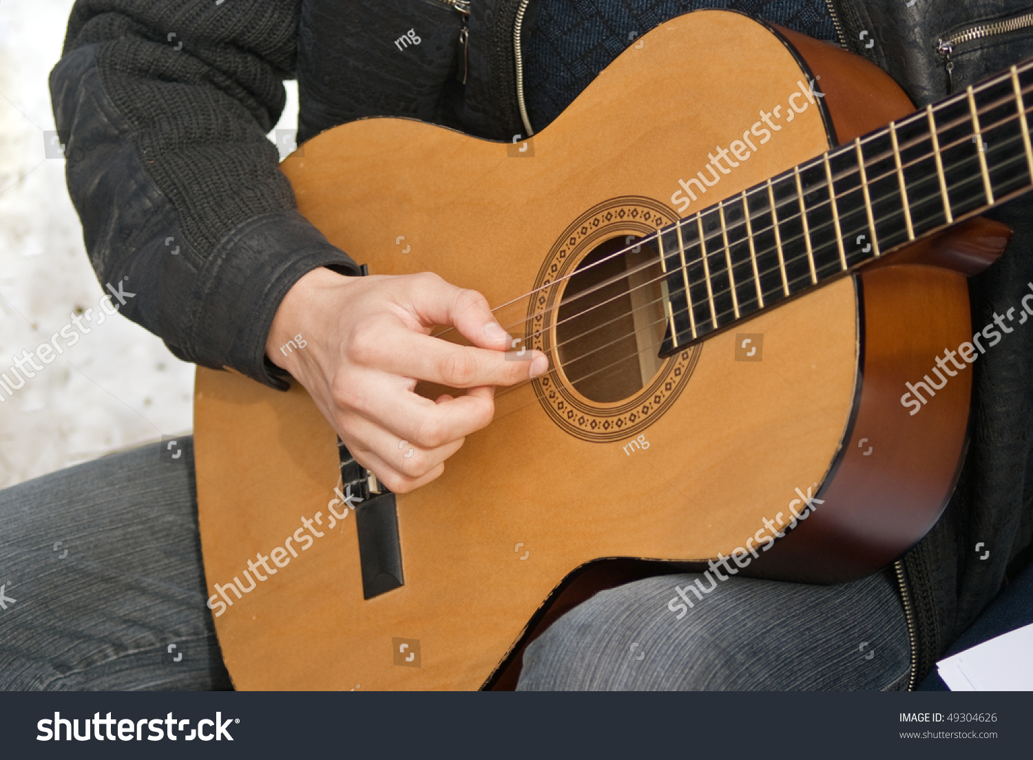 guitarist playing in picnic against snow