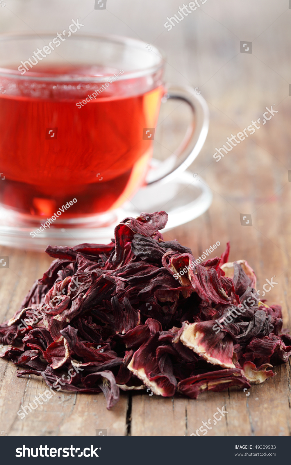 Heap Of Dried Hibiscus Calyces Against A Cup Of Hibiscus Tea Stock ...