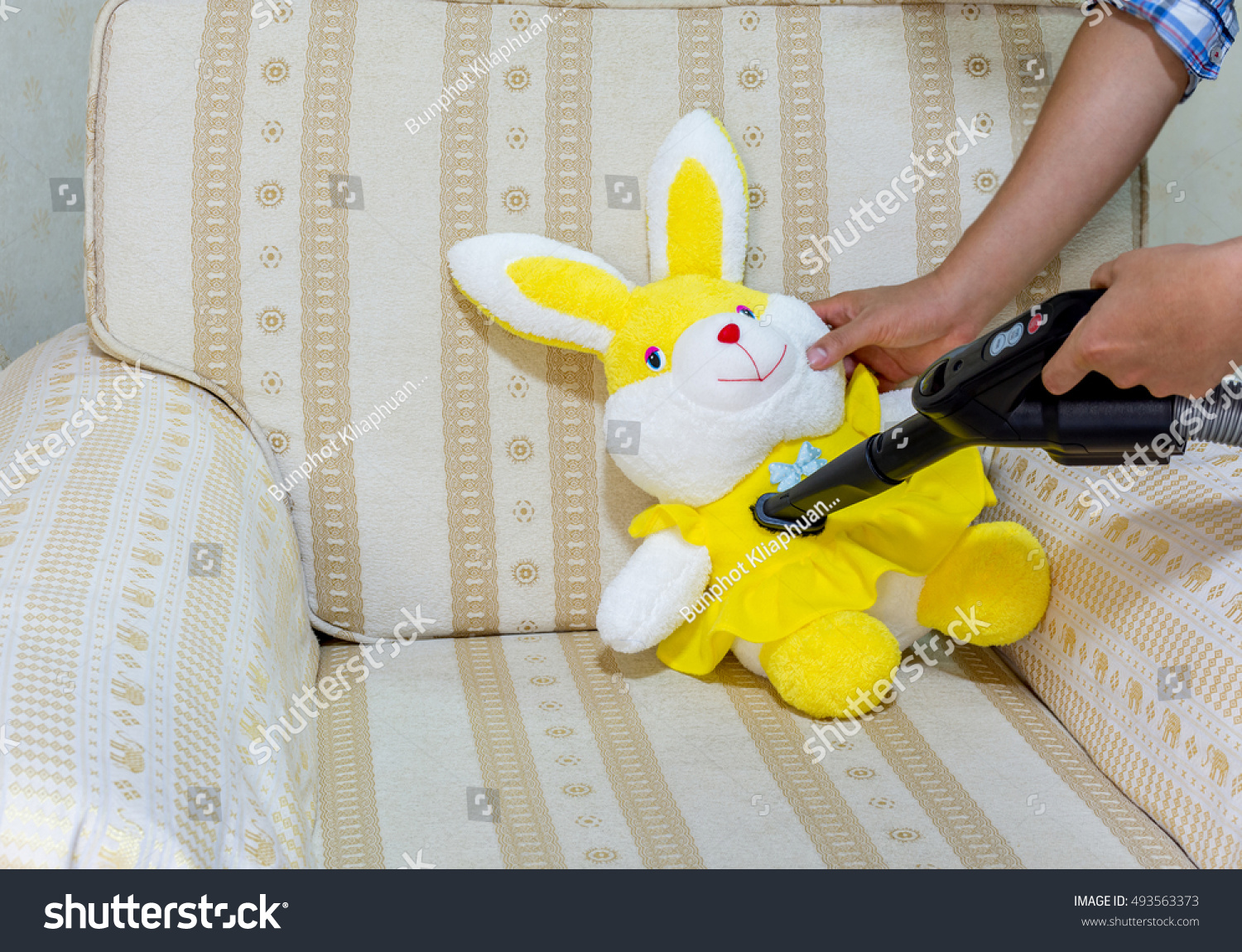 use vacuum cleaner clean doll prevent stock photo 493563373 shutterstock. Black Bedroom Furniture Sets. Home Design Ideas