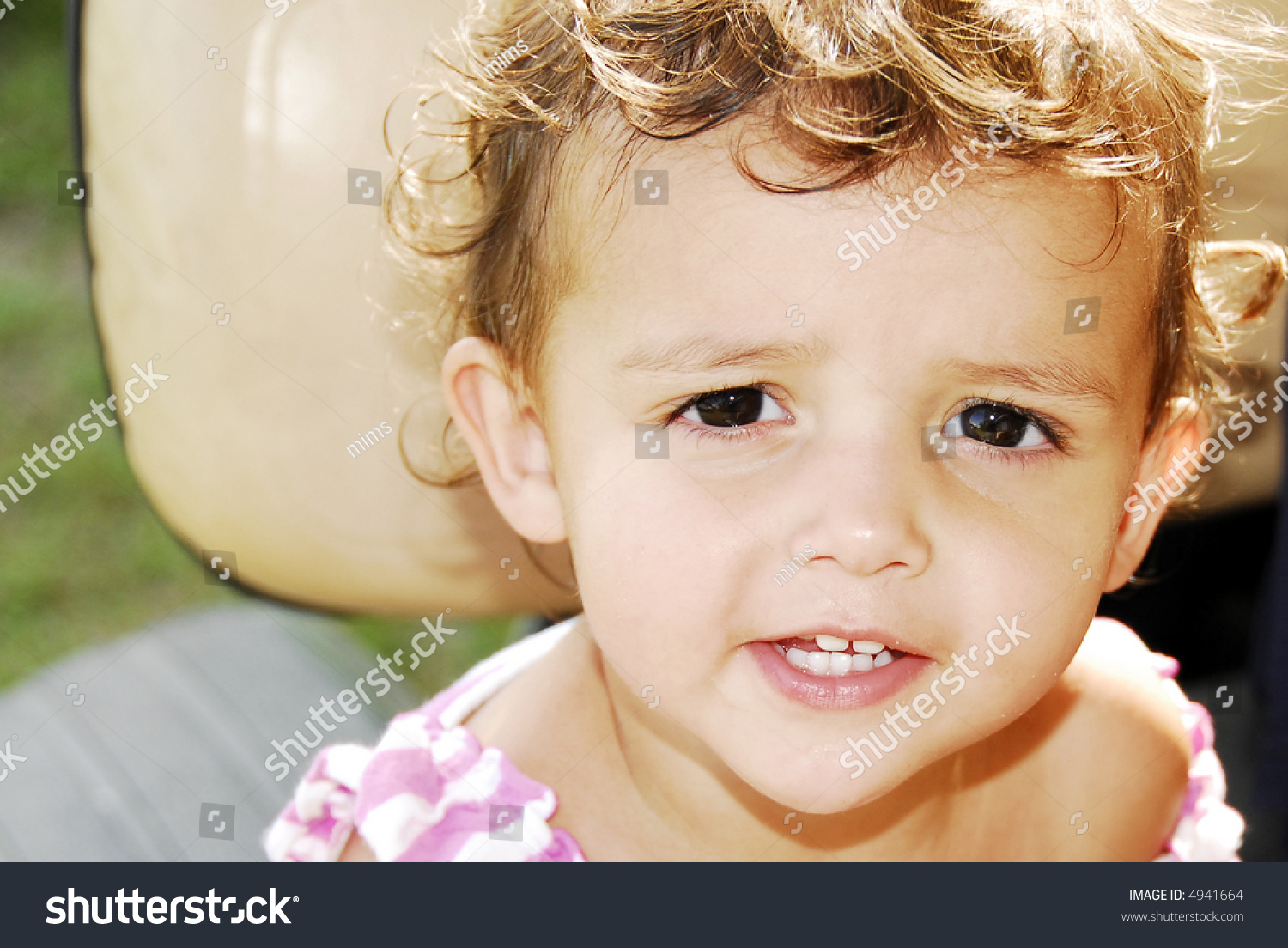 beautiful baby girl brown eyes brunette stock photo (royalty free