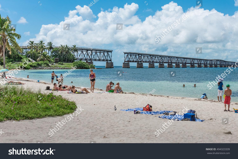 Bahia Honda Key, Florida - October 5, 2016: People enjoy the beach at Bahia Honda State Park, adjacent to an old abandoned bridge, in lower Florida Keys.