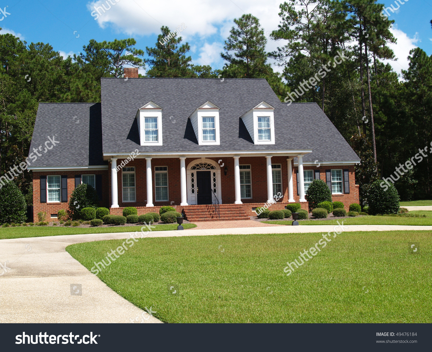 Two story brick residential home with large front porch for House with side garage