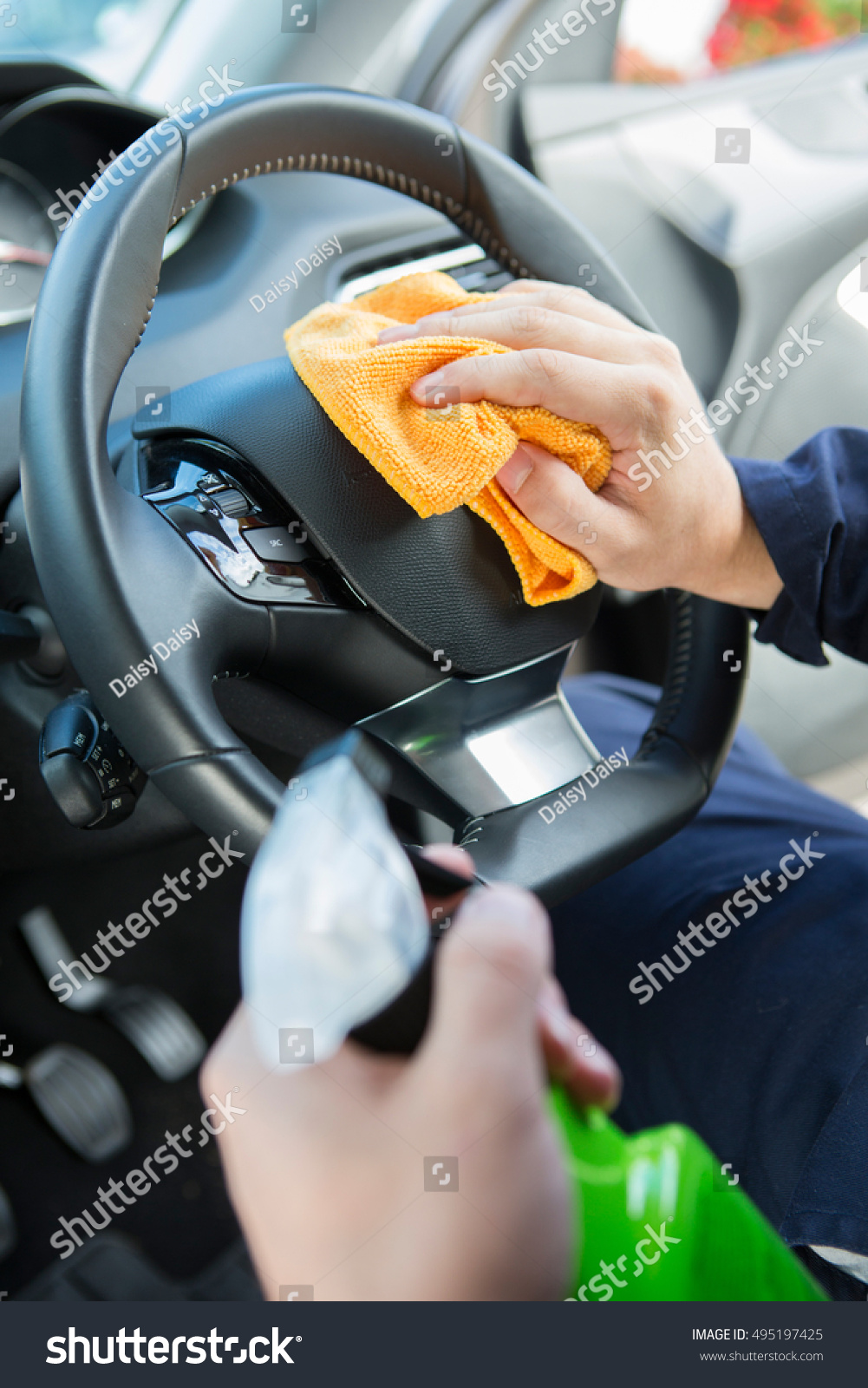 close of man cleaning interior of car stock photo 495197425 shutterstock. Black Bedroom Furniture Sets. Home Design Ideas