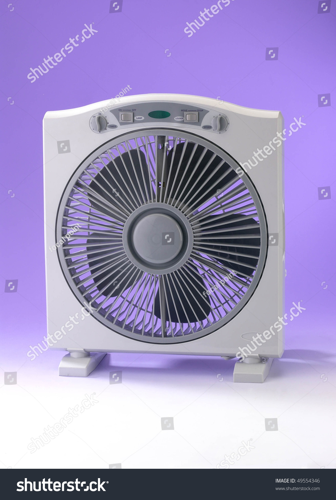 Modern Desk Fan : Modern desk cooling fan over white and purple background