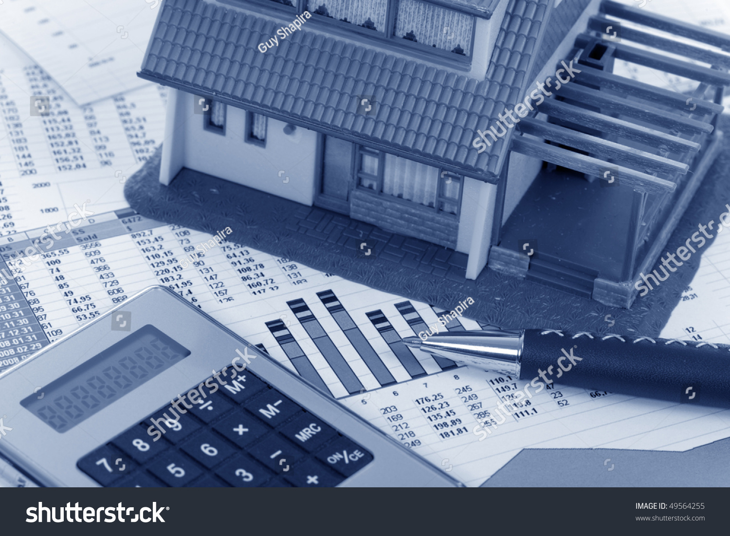 Model house and calculator on construction plan stock for House construction calculator