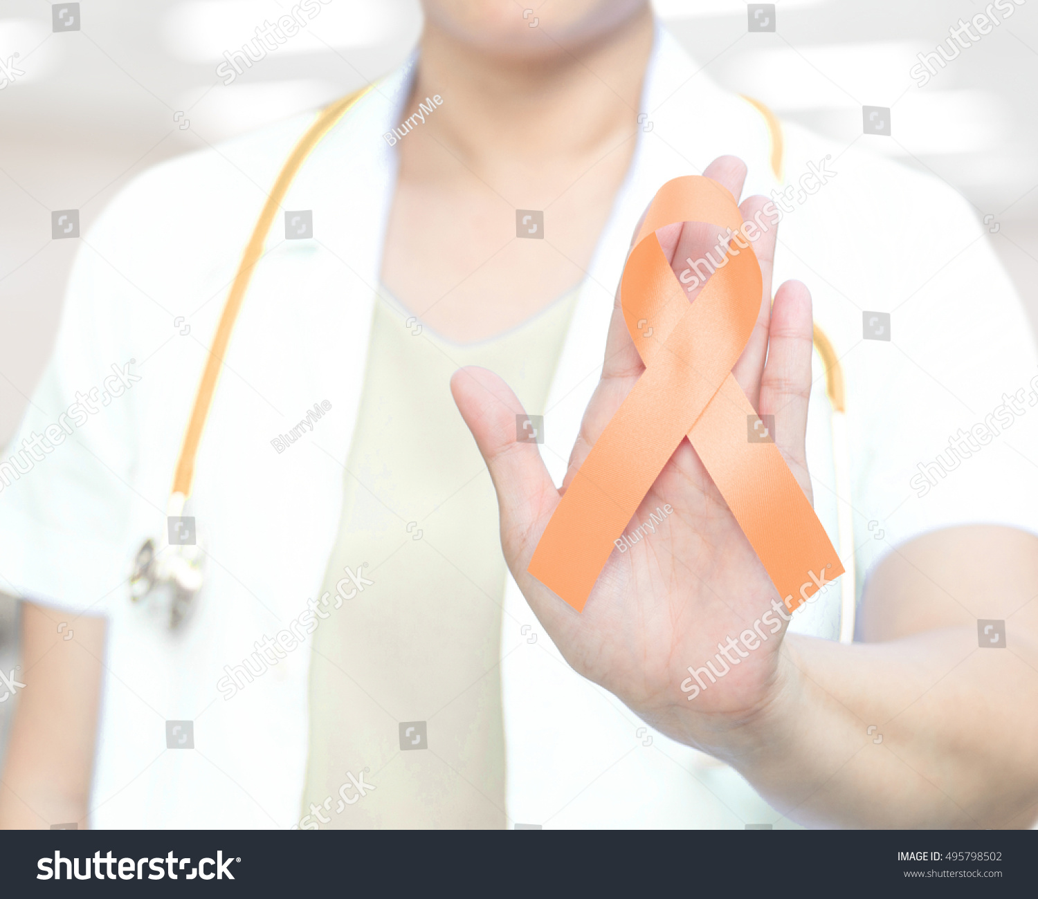 Female doctor white uniform peach ribbon stock photo 495798502 female doctor in white uniform with peach ribbon awareness in hand as stop sign for endometrial buycottarizona