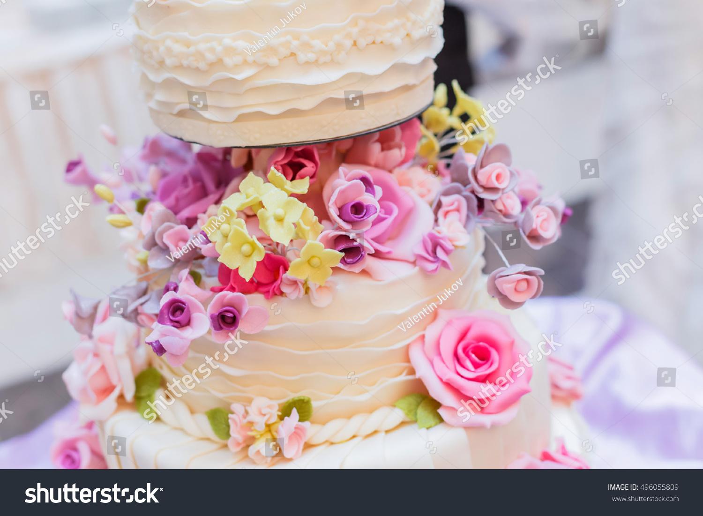 White Wedding Cake With Flowers On Holiday Background Dessert Ez