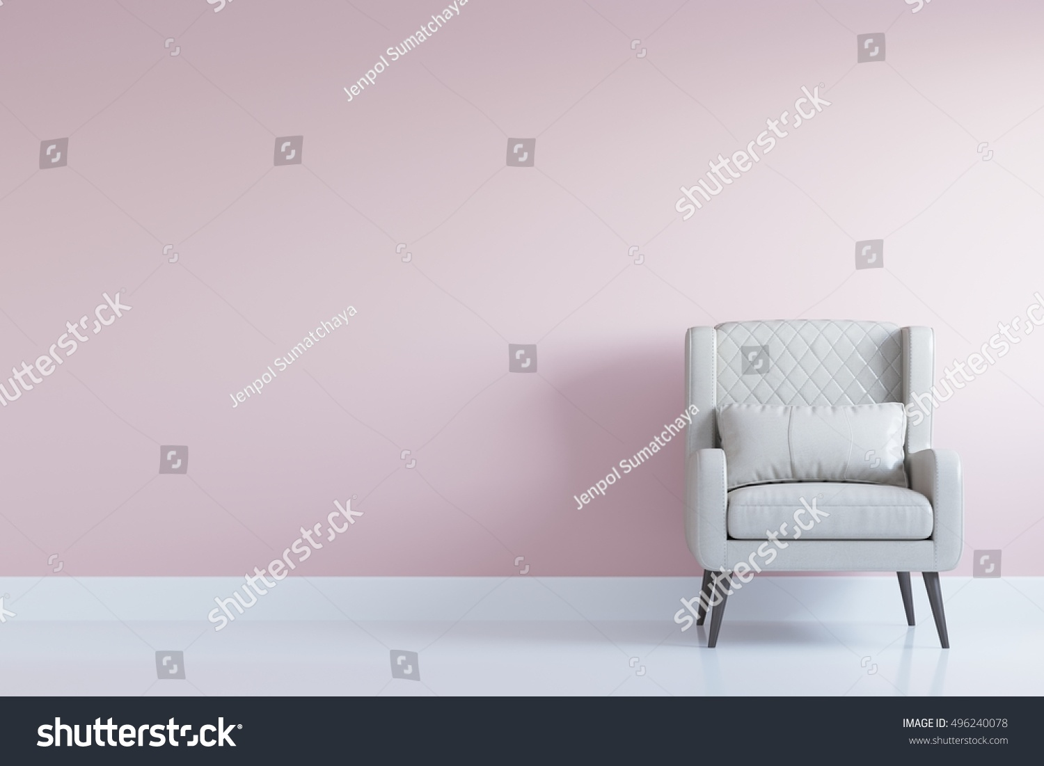 white comfortable arm chair in interior living room with pastel pink wall for copy space