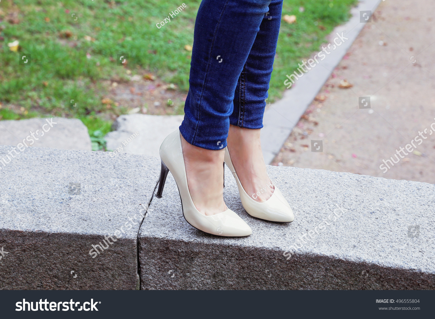 a6e7636f75 Shapely female legs in blue jeans and beige patent leather high-heeled  shoes. Fashionable