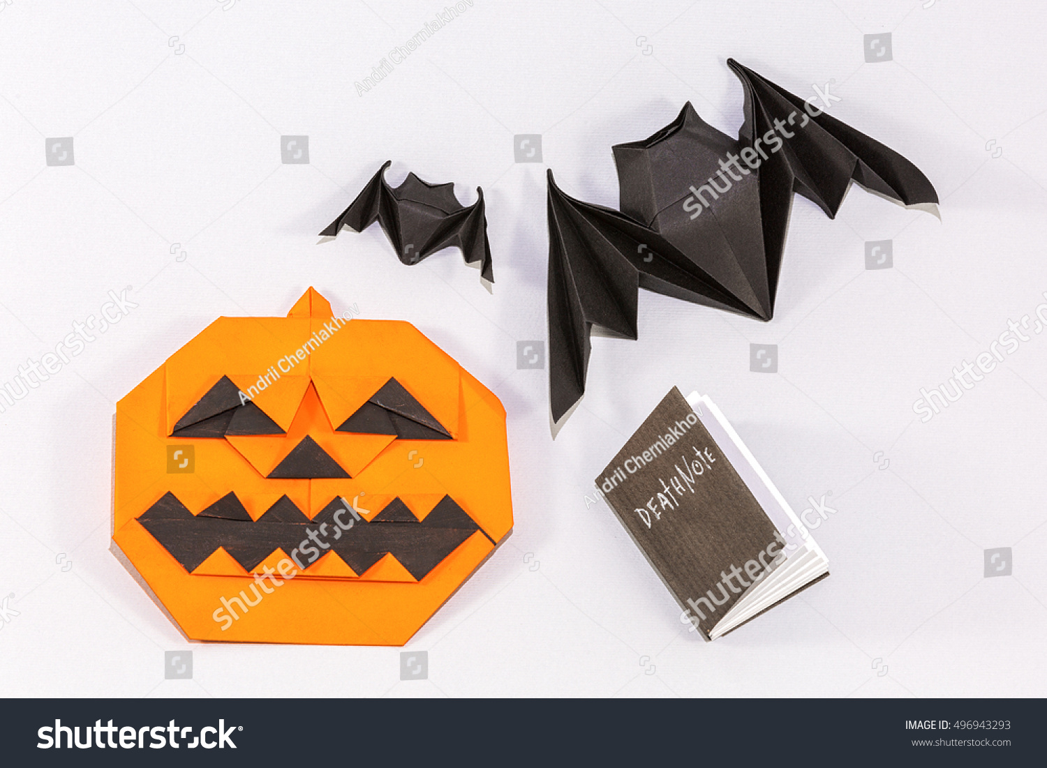 Halloween origami pumpkin jackolantern deaf note stock photo halloween origami pumpkin jack o lantern with deaf note and bats jeuxipadfo Gallery