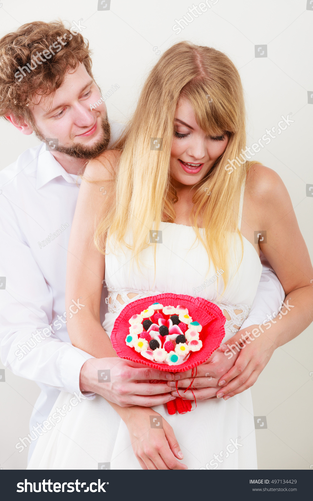 Images Of Candy Loving Great loving couple candy bunch bouquet flowers stock photo 497134429