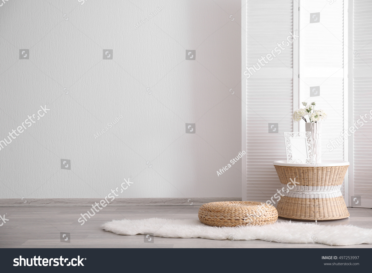 Room interior with white decorations and wicker furniture #497253997
