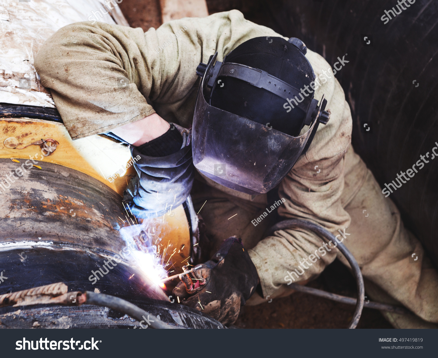 Royalty-free Repair of heating duct  The workers,… #497419819 Stock