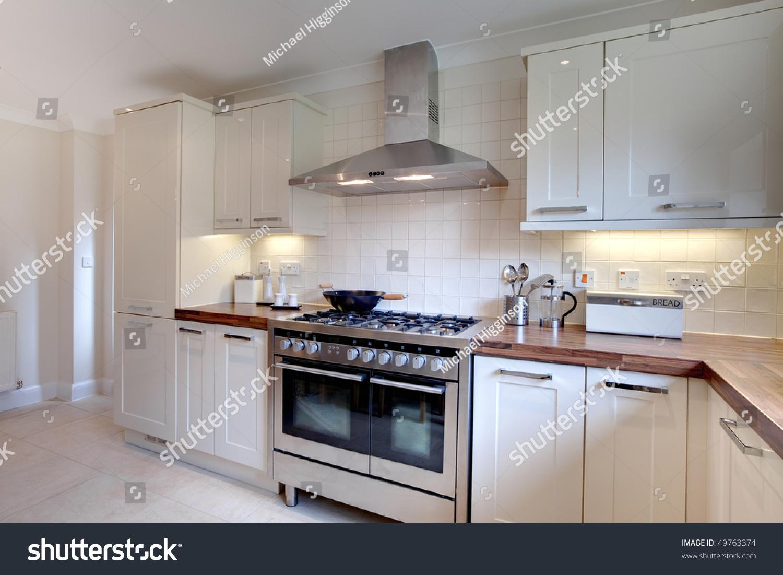 English Hob Kitchen ~ Contemprary cream colored modern kitchen range stock photo