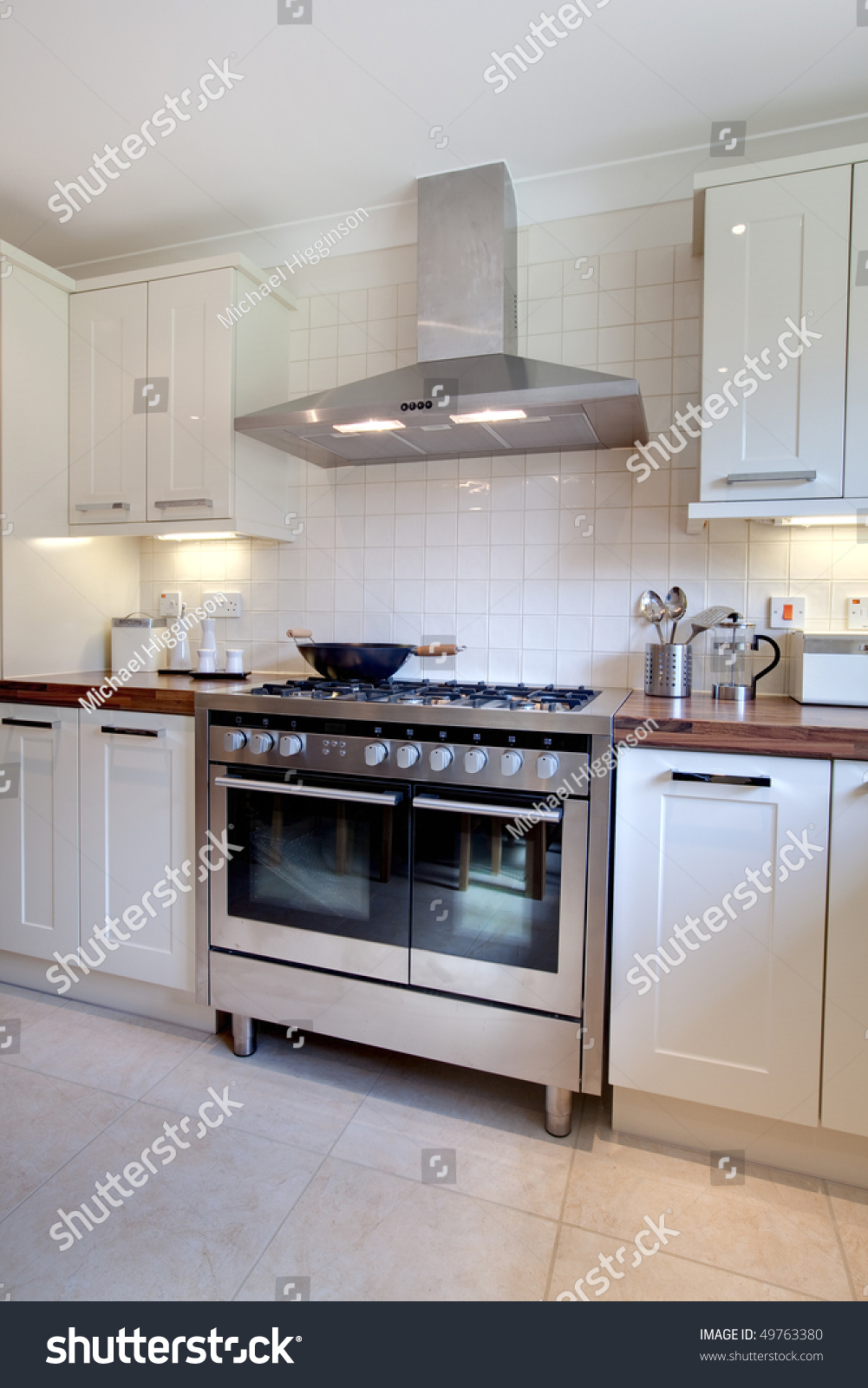 Cooker In Kitchen ~ Modern kitchen containing range style stainless stock