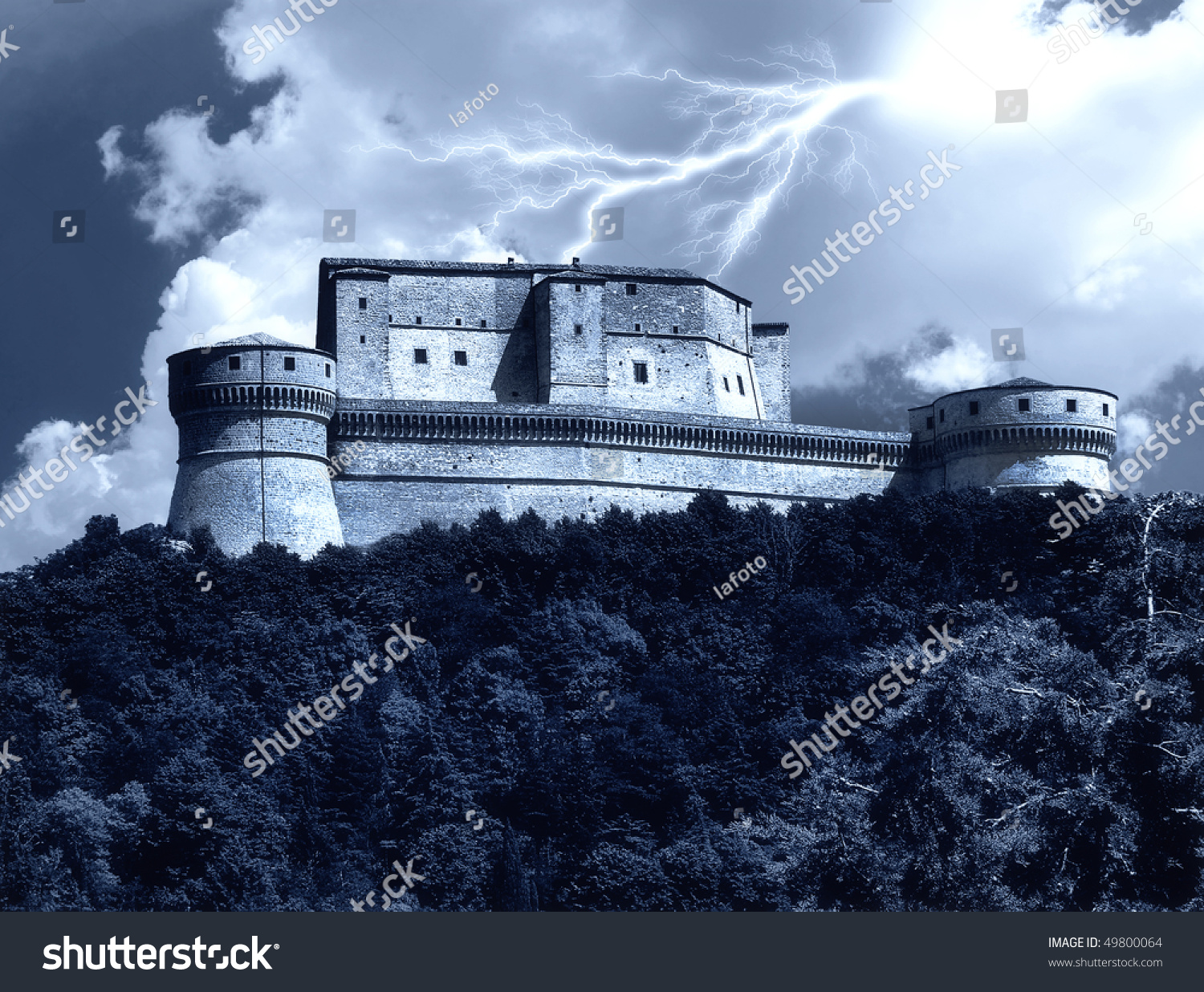 scary castle surrounded by lightning stock photo royalty free