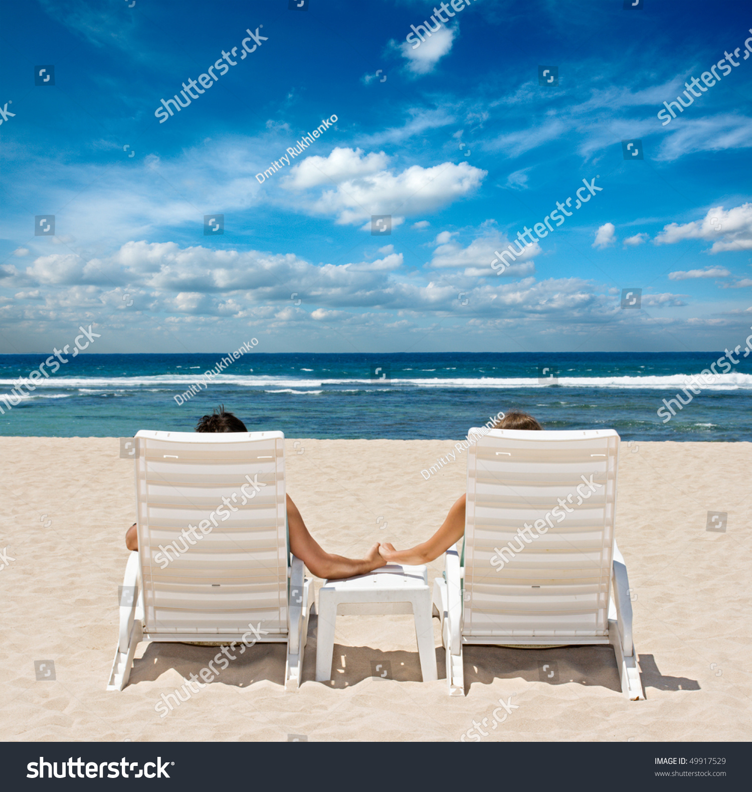 Honeymoon Couple Sunbathing In Beach Chairs