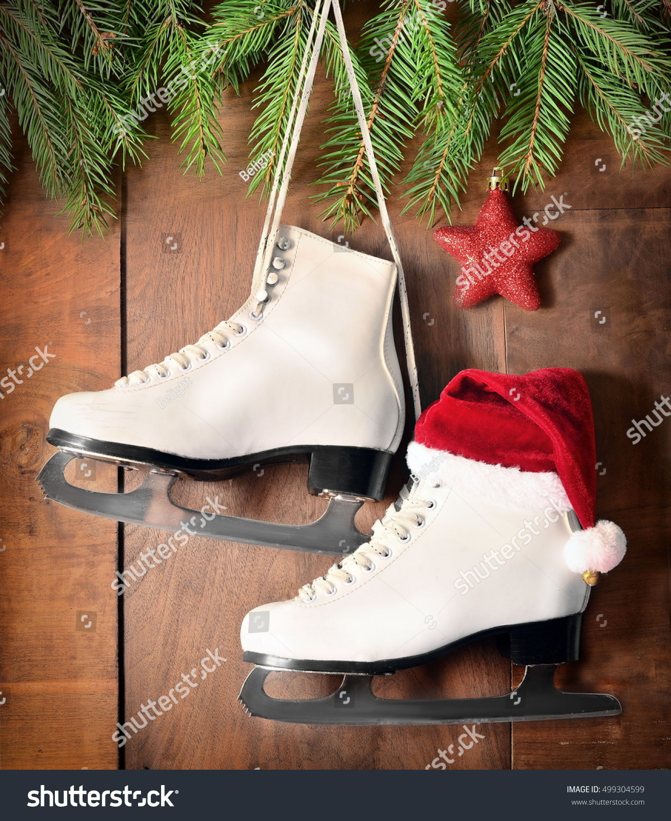 christmas decoration white ice skates for figure skating hanging on a wooden background