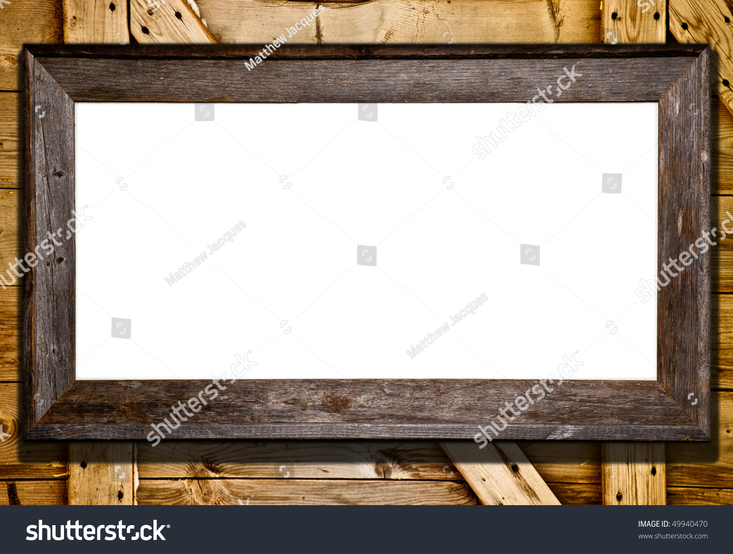 rustic wood frame against barn door or wood panel background blank white template for your