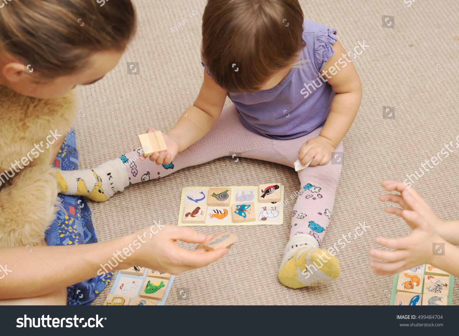 daddy kids playing childrens lotto figures stock photo 499484704