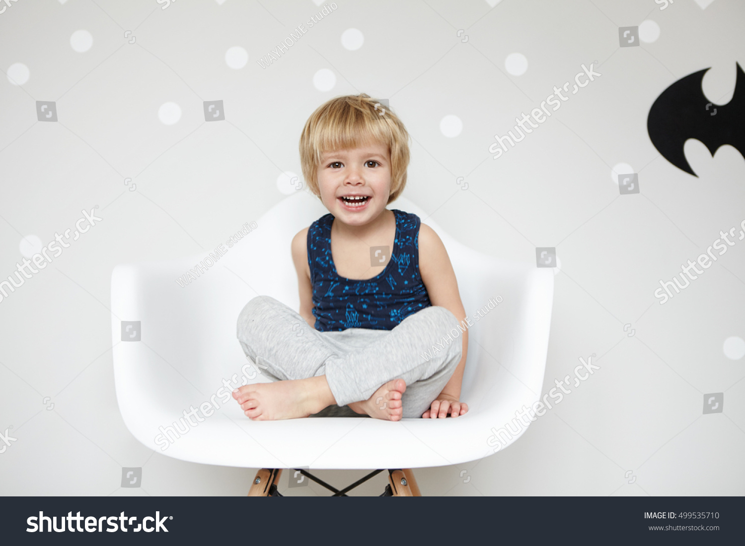 Portrait playful toddler fair hair wearing stock photo for Toddler sitting chair