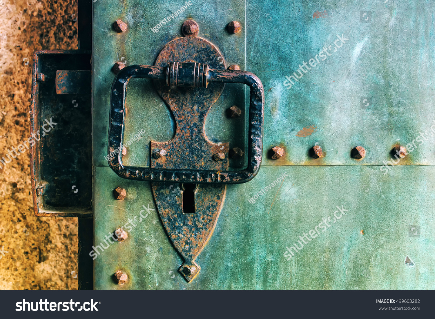 Old Rustic Copper Metal Castle Door With Large Knocker Weathered Surface Texture
