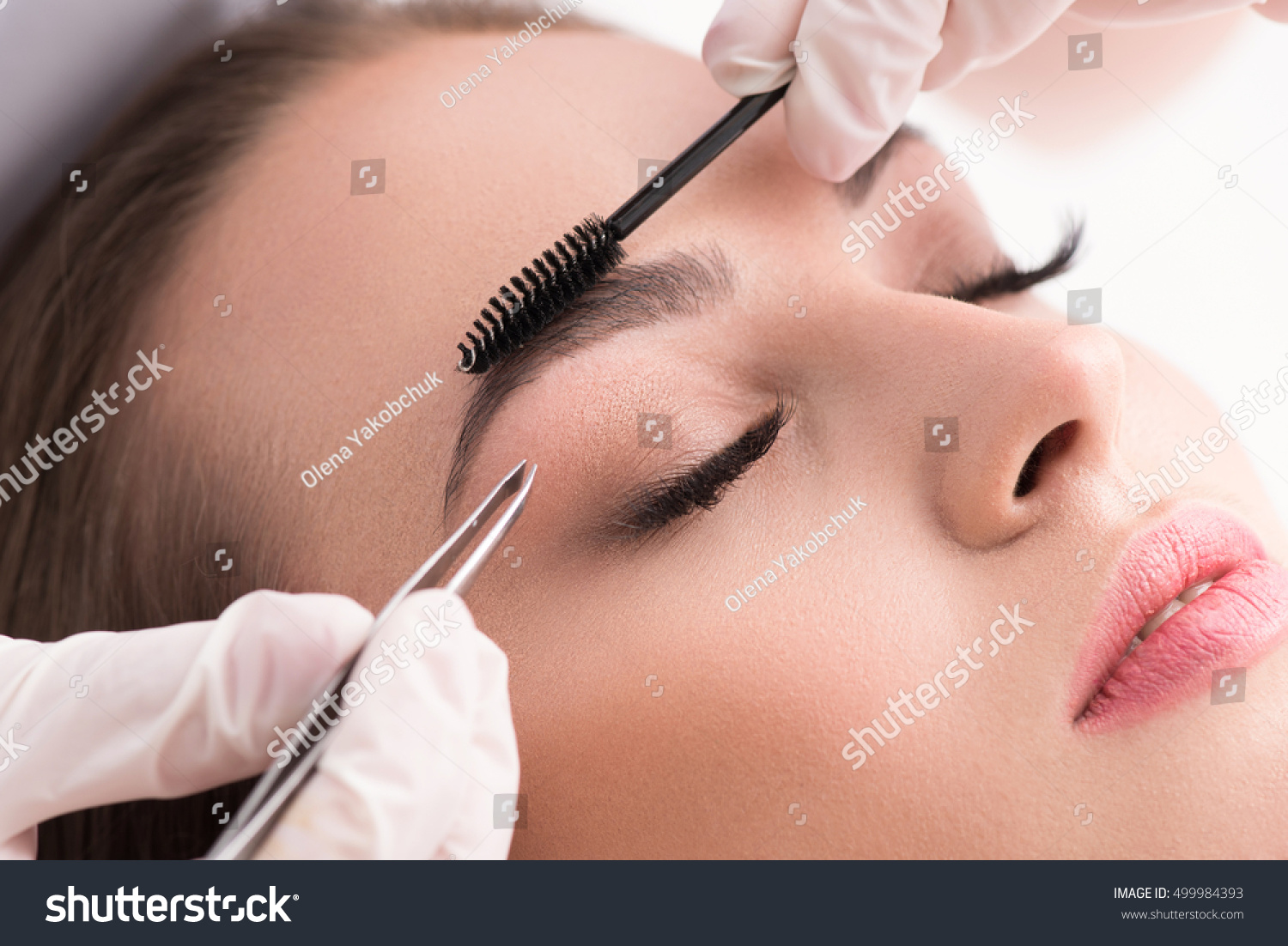 Young Woman Tweezing Her Eyebrows Beauty Stock Photo Edit Now