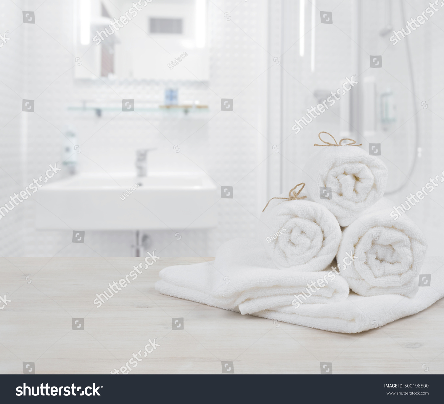 White Folded Spa Towels On Defocused Stock Photo (Royalty Free ...