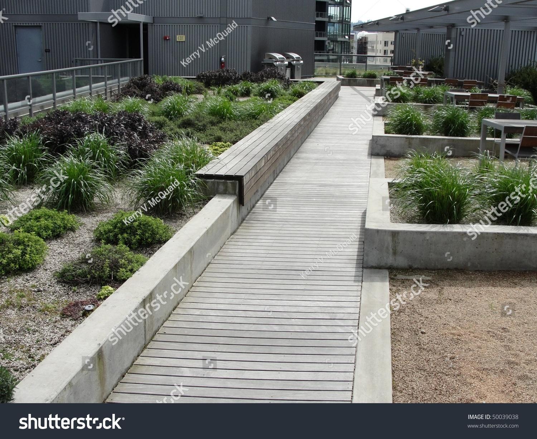 green eco roof design on modern office building stock. Black Bedroom Furniture Sets. Home Design Ideas