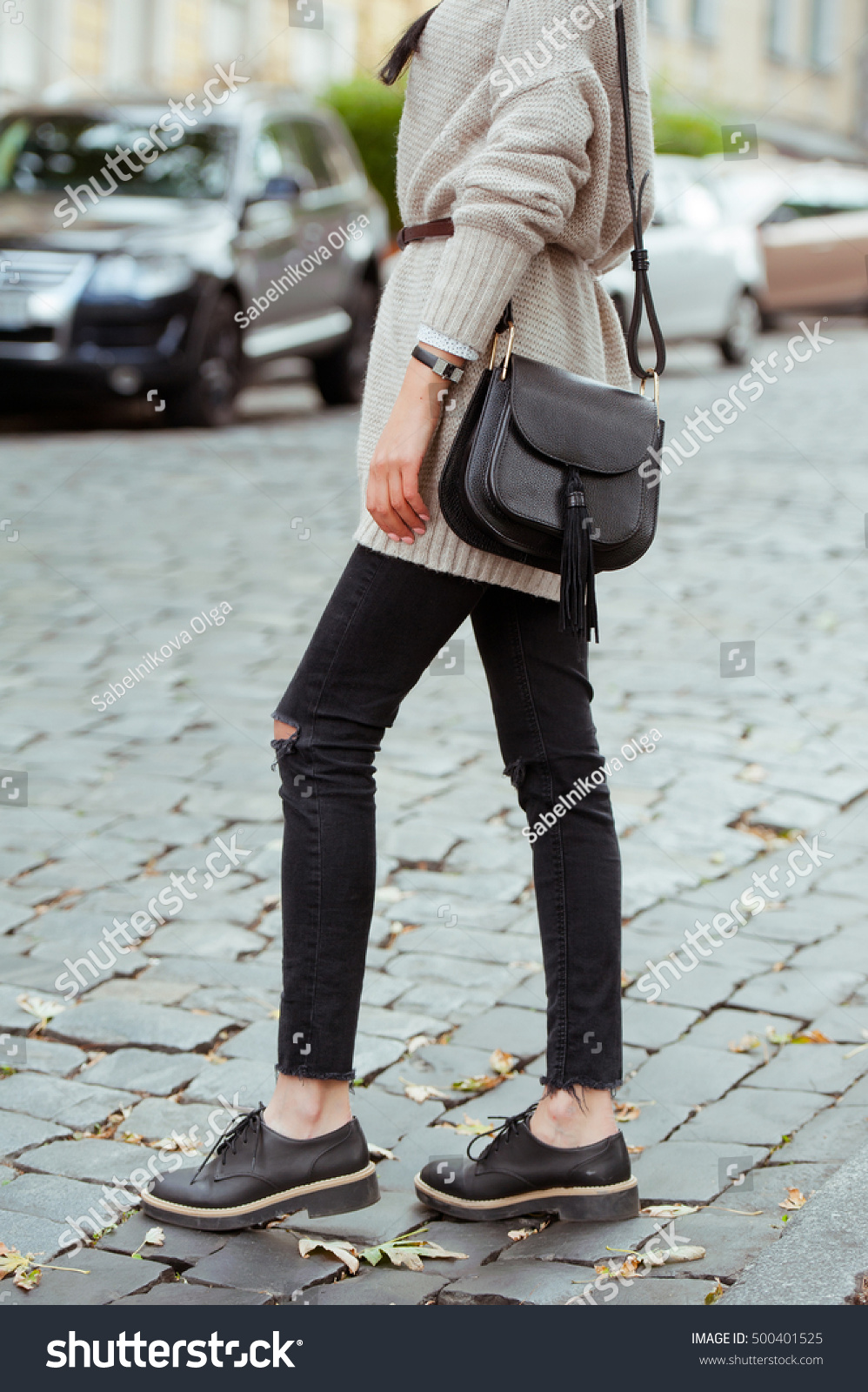Fashionable Young Woman Black Jeans Beige Stock Photo 500401525 ...