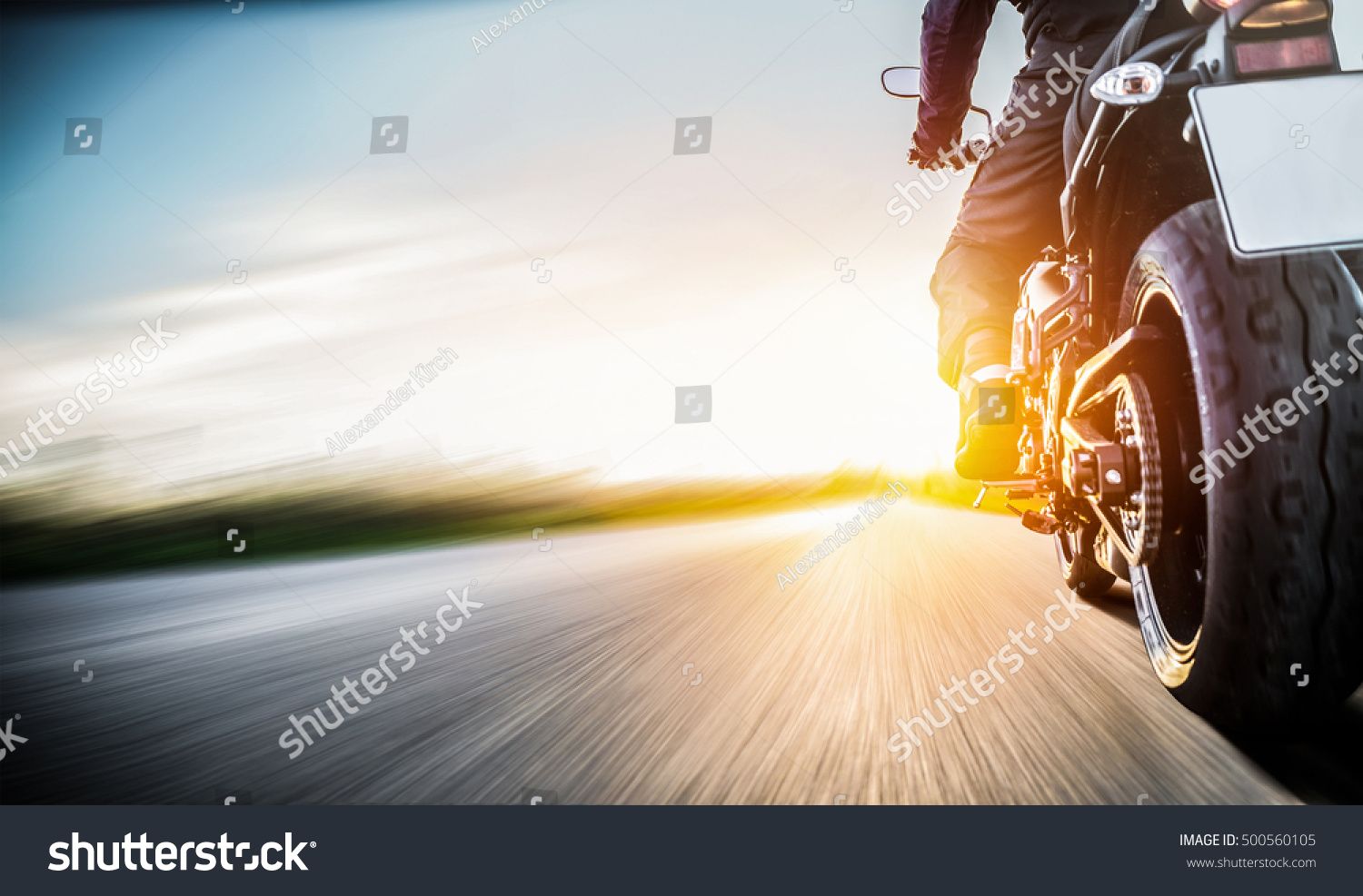 motorbike on the road riding. having fun driving the empty road on a motorcycle tour journey. copyspace for your individual text. #500560105