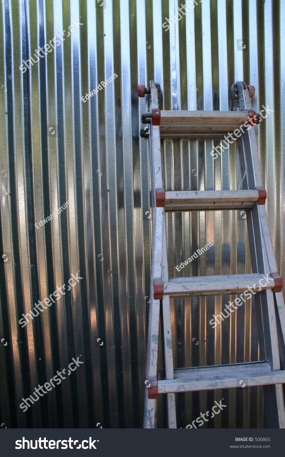Ladder Against Shiny Silver Corrugated Aluminum Stock