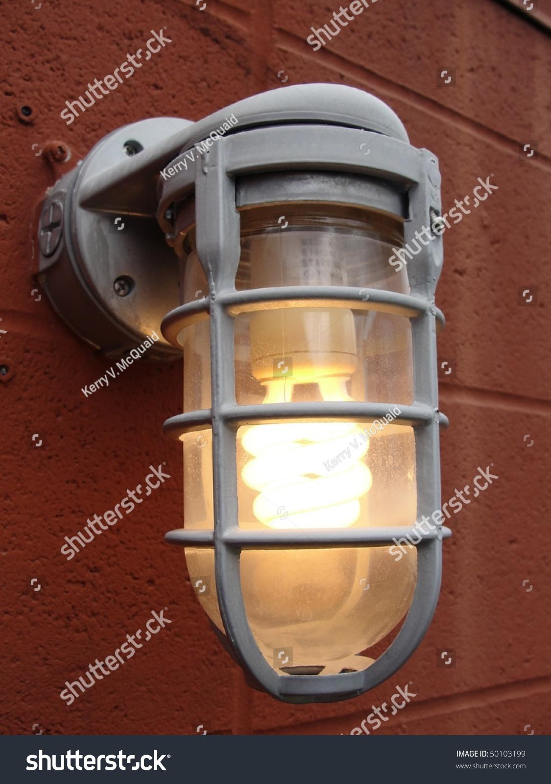 Illuminated lit compact fluorescent light bulb stock photo an illuminated lit compact fluorescent light bulb cfl in an outdoor fixture aloadofball Images