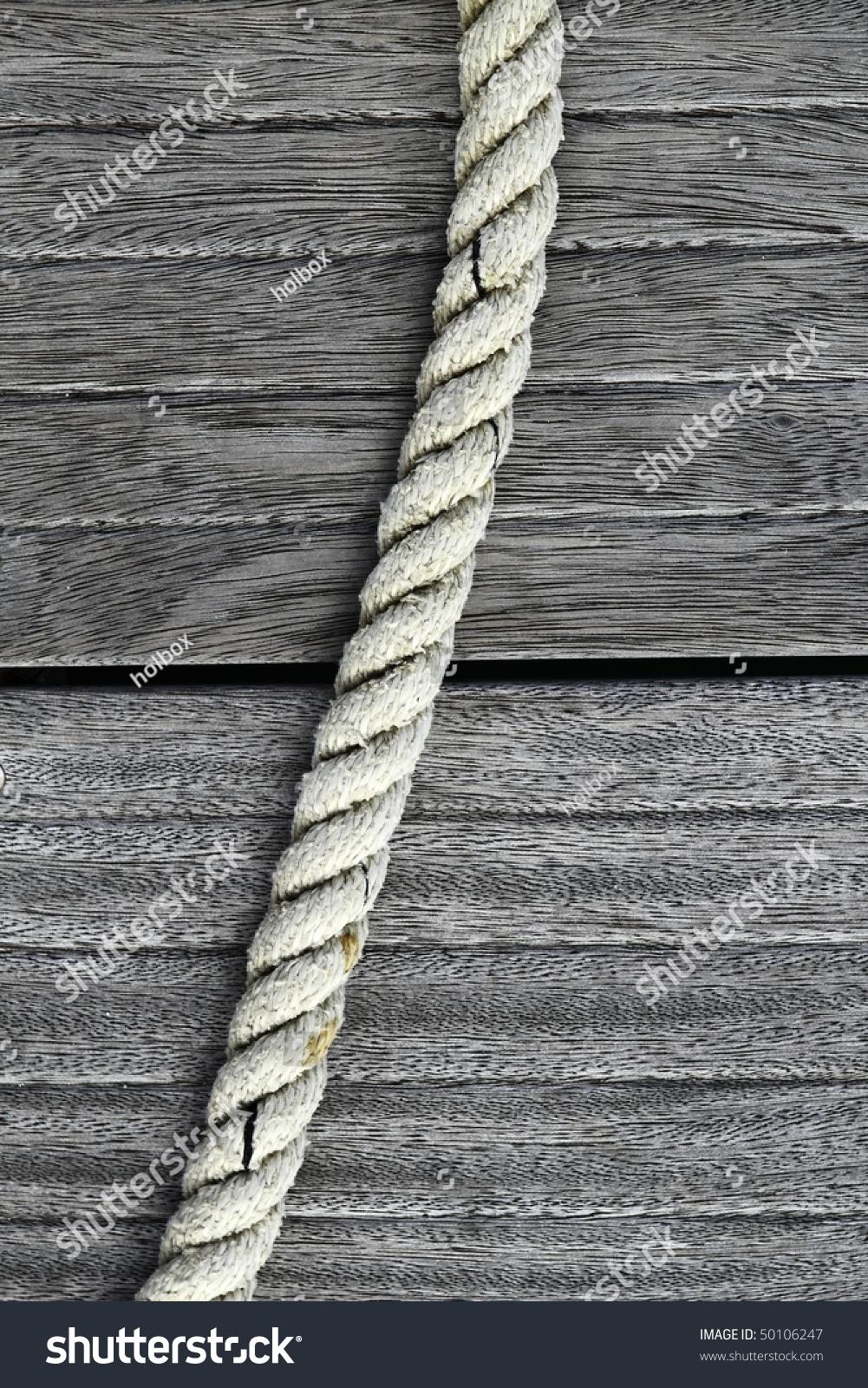 Teak Wood Stocks ~ Marine rope gray aged teak wood stock photo