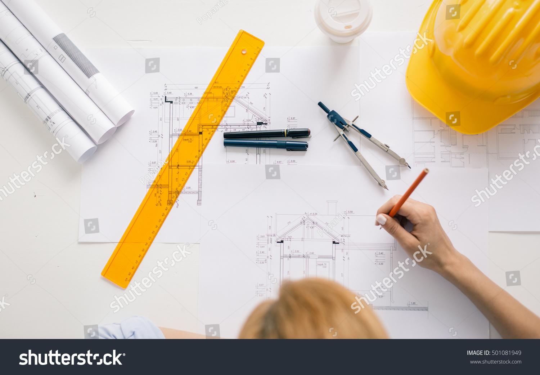 Architect drawing blueprints architecturalengineering for Architectural engineering concepts