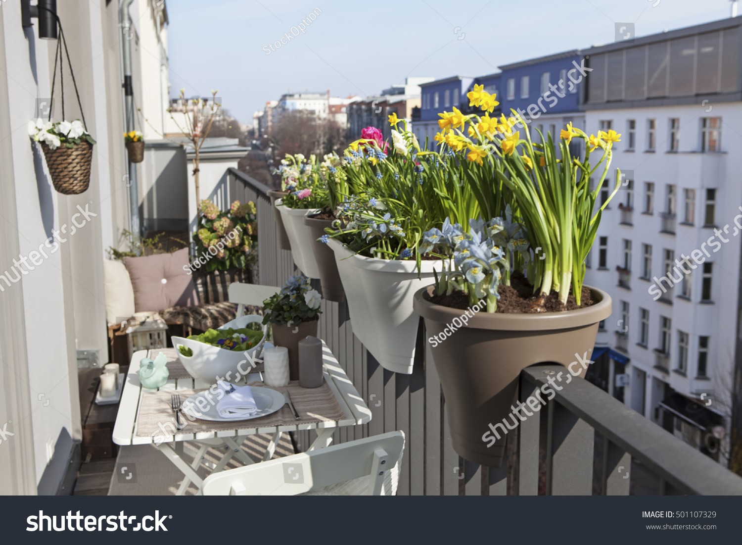 Potted Spring Flowers On Sunny Balcony Stock Photo Edit Now