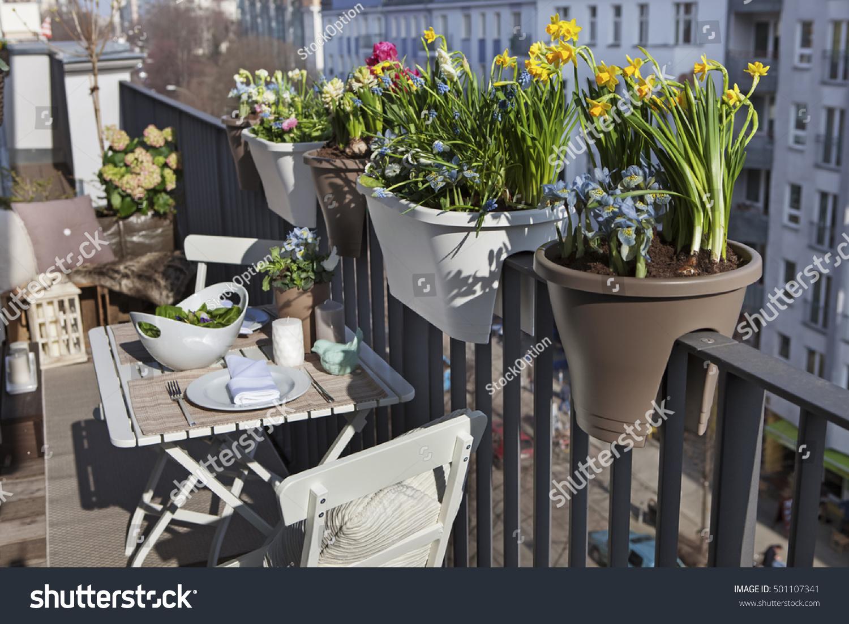 Potted spring flowers on sunny balcony stock photo download now potted spring flowers on a sunny balcony in the city mightylinksfo