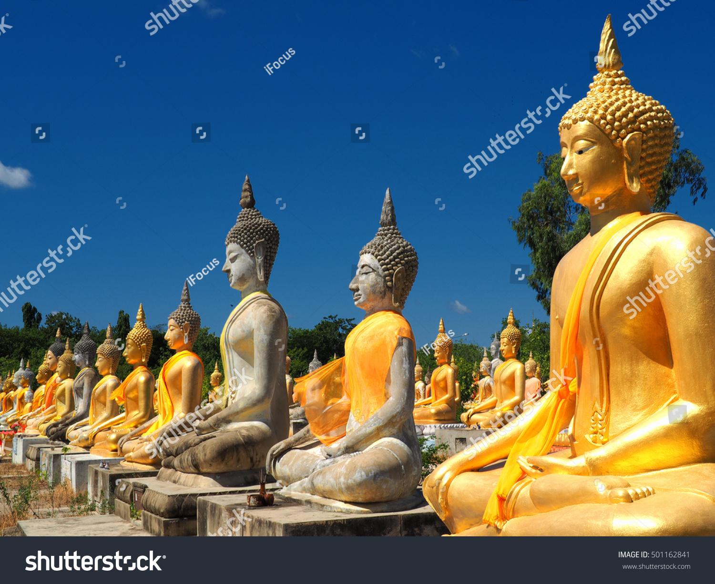 Meditating Buddhas at Buddhist temple Wat Phai Rong Wua