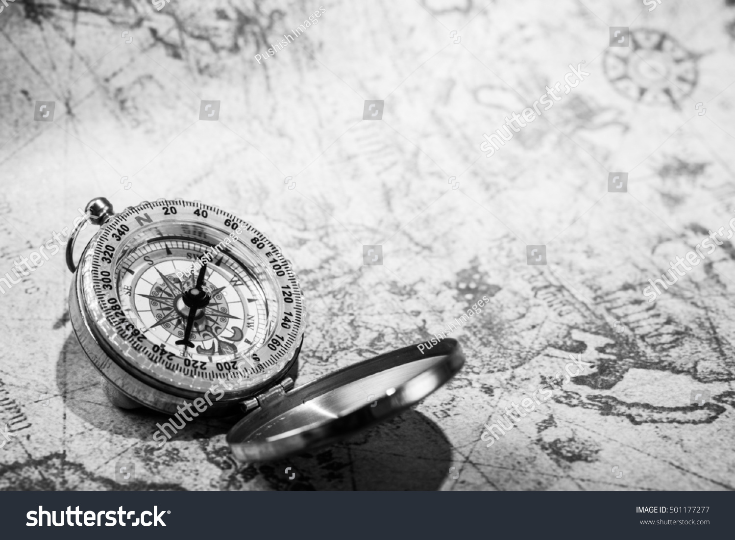 VIntage Compass On Old Map Black And White Photo