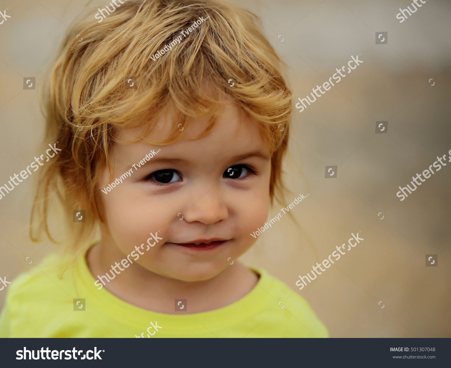 cute baby boy child curly blond stock photo 501307048
