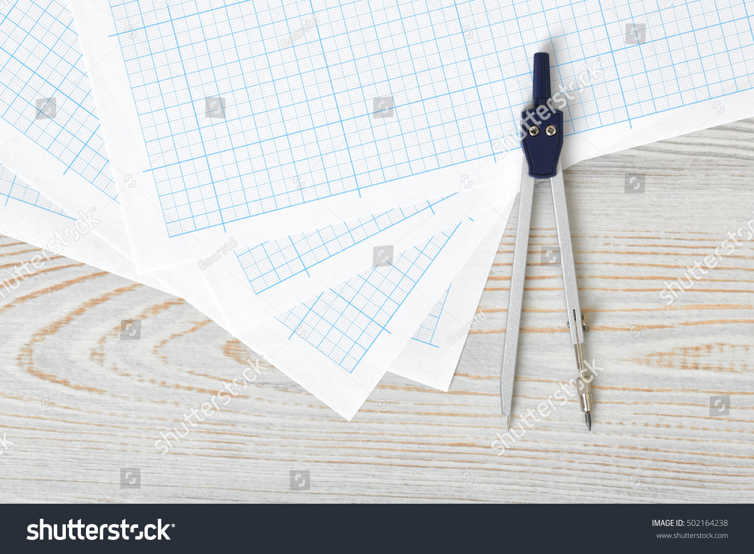 compass on graph paper top view stock photo edit now 502164238
