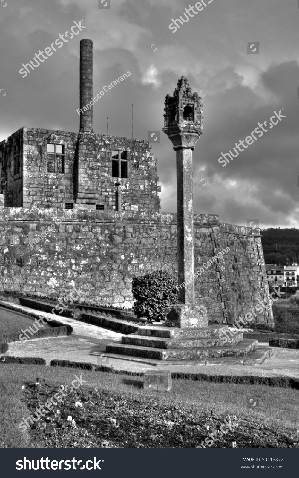 barcelos city castle under dark cloudy sky black and