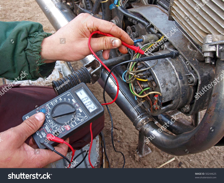 checking motorcycle engine generator multimeter stock photo edit