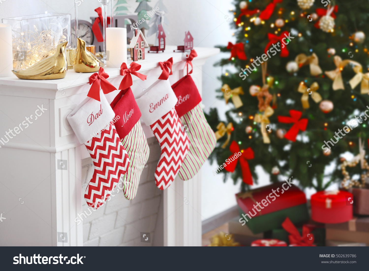Christmas socks hanging on fireplace in room interior
