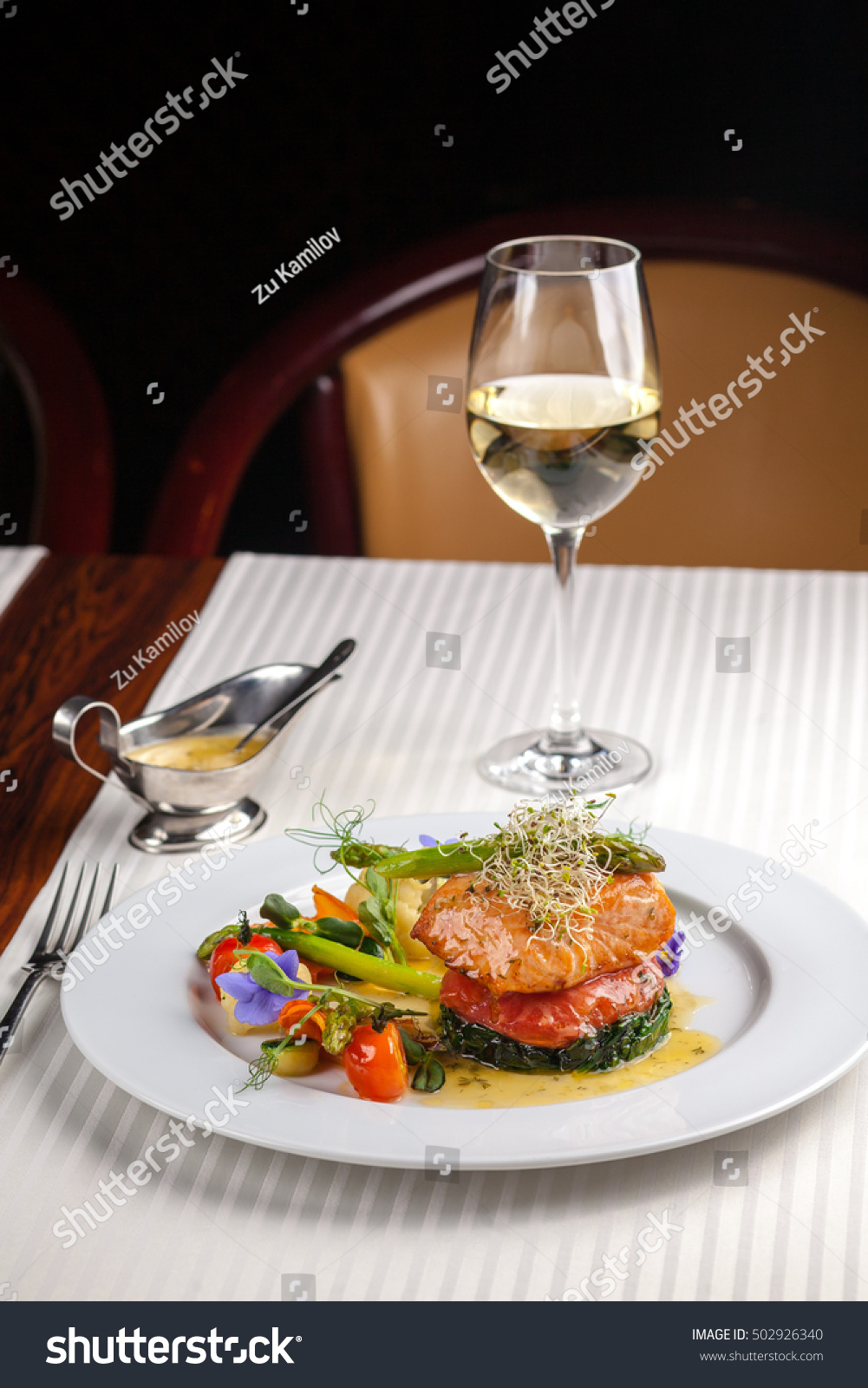 Beautiful serving dishes restaurant red fish stock photo for Fish dish menu