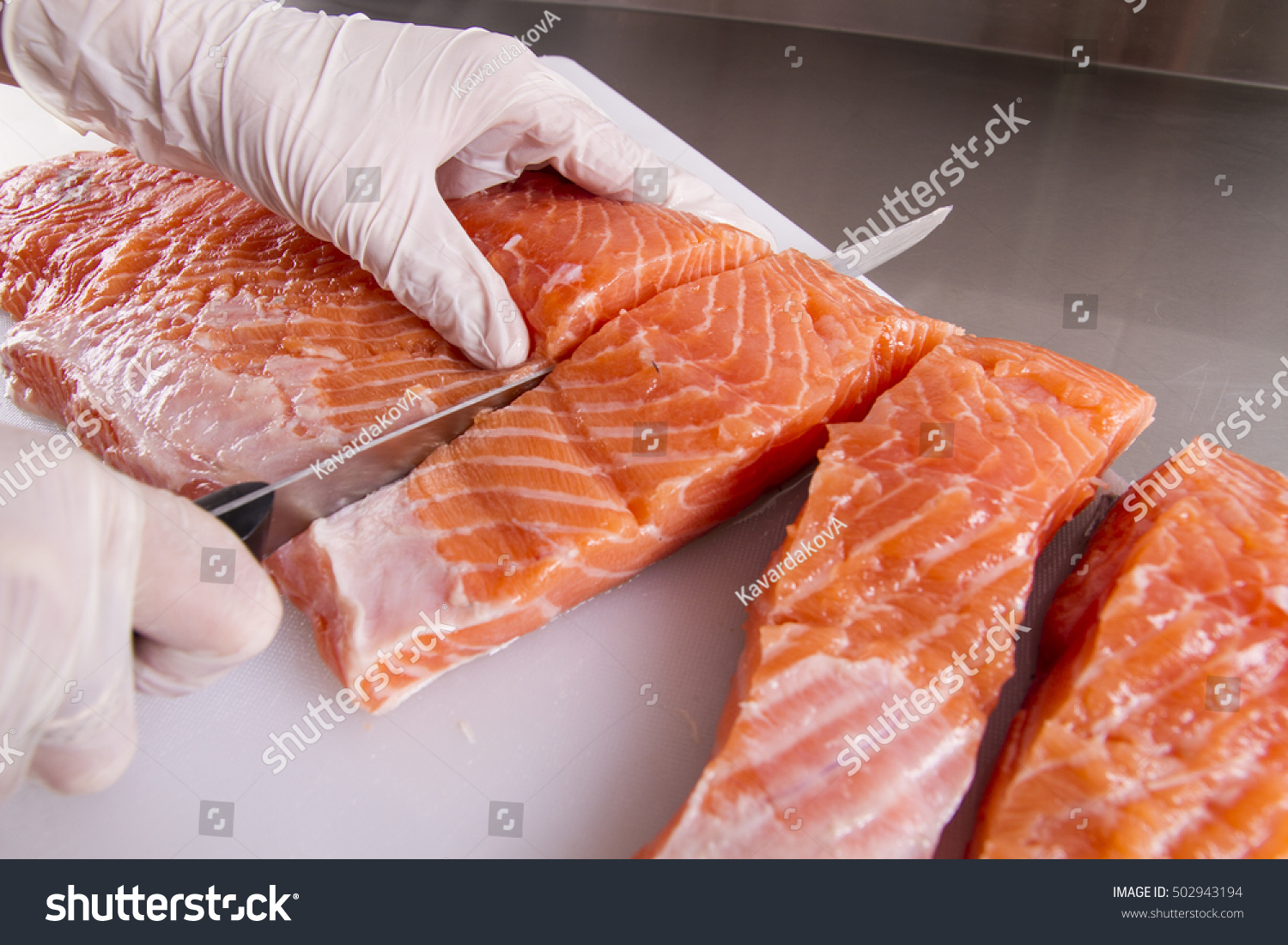 Cook Cut Up Raw Fresh Fish In Kitchen Stock Photo